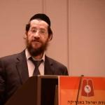Harav-Meir-Tzvi-Spitzer,-RM-Yeshivas-Mir-giving-Halacha-Shiur-at-Agadas-Yisroel's-16th-Yerusholayim-Yarchei-Kallah